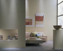 Ein Zimmer mit der Innenraumfarbe von Sto in gelb